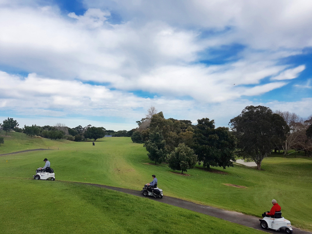 moore park golf hub, image of several participants on paragolfers on their way out to the course