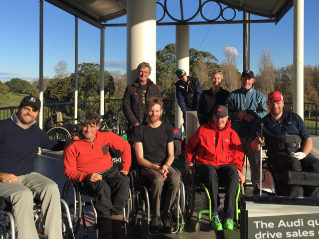 volunteering with empower golf, image of volunteers and coaches with players after a clinic