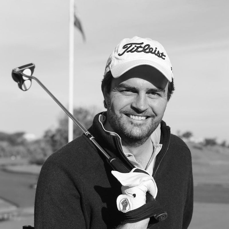about empower golf, james gribble, coach and founder, black and white photo with golf club