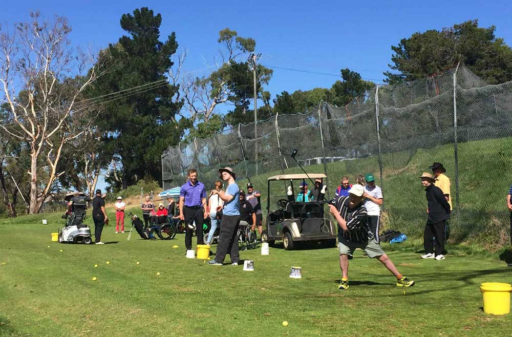 donate to empower golf, image of golf clinic